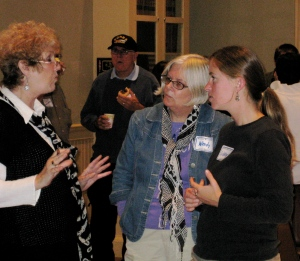Wendy Wingate and Libby Ladner (center and right) talk with a community member.
