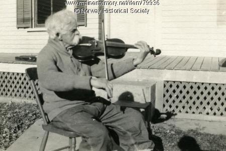 Mellie Dunham playing his fiddle, ca. 1927