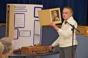 "Irene Hutchinson talks about John Edward Barry, the subject of the exhibit, ""A Man's Life in Suitcase."" (Photo: Nick Waugh)"