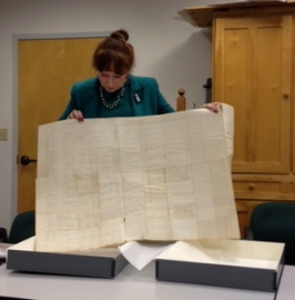 Kim Smith displays the Presque Isle Historical Society's Civil War enlistment record.