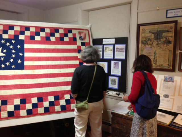 Belfast Library staff Betsy Paradis and Brenda Harrington admire the quilt.